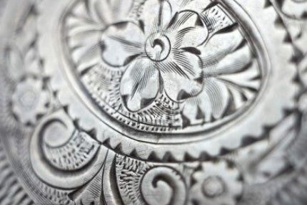 engraved silver flower